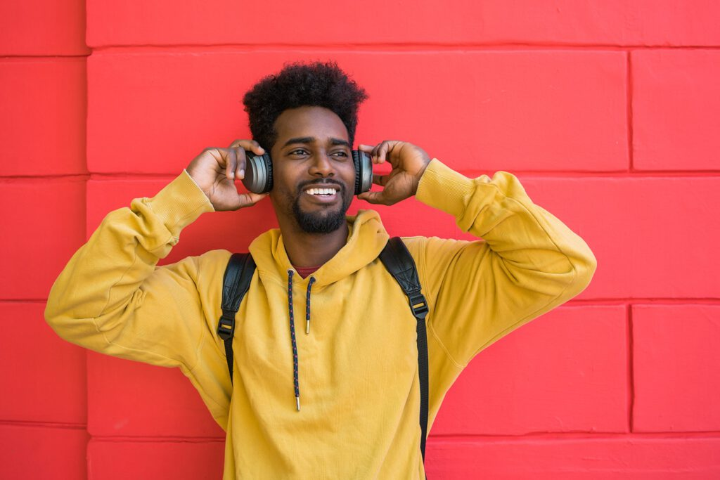 young-afro-man-listening-to-music-with-headphones-
